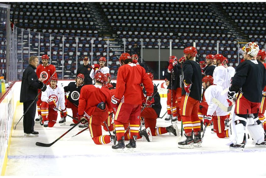 Calgary Flames newly appointed head coach Geoff Ward (L) leads practice in Calgary at the Saddledome on Friday, November 29, 2019. The NHL team officially announced Bill Peters will no longer coach the team and it has accepted Peters' resignation. Jim Wells/Postmedia
