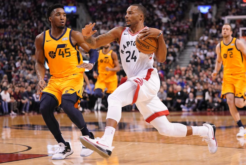 Raptors guard Norman Powell (24) drives to the net against Utah Jazz guard Donovan Mitchell (45) during the first half at Scotiabank Arena on Sunday. John E. Sokolowski-USA TODAY Sports
