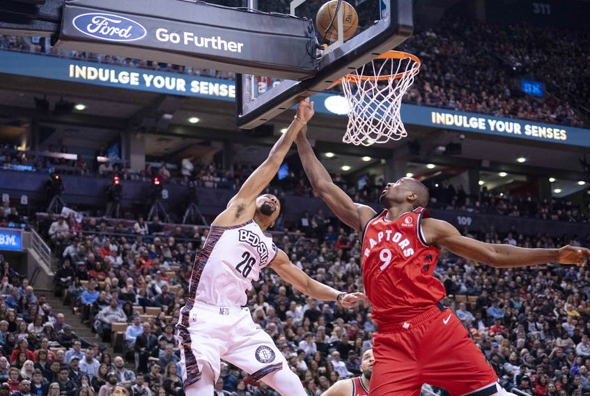 Brooklyn Nets guard Spencer Dinwiddie (26) drives to the basket over Toronto Raptors centre Serge Ibaka (9) during the fourth quarter at Scotiabank Arena. Nick Turchiaro-USA TODAY Sports