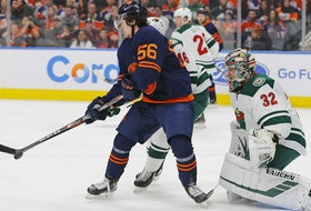 Edmonton Oilers forward Kailer Yamamoto (56) deflects a shot against Minnesota Wild goaltender Alex Stalock (32) at Rogers Place on Feb 21, 2020.