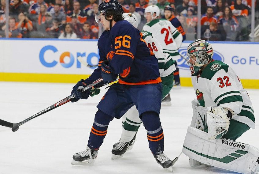 Edmonton Oilers forward Kailer Yamamoto (56) deflects a shot against Minnesota Wild goaltender Alex Stalock (32) at Rogers Place on Feb 21, 2020.