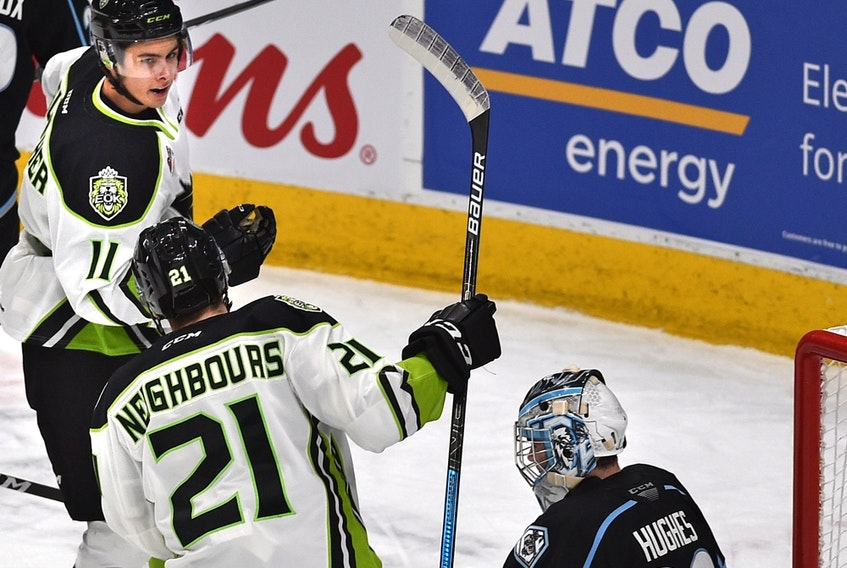 Edmonton Oil Kings Dylan Guenther (11) celebrates his goal wtih Jake Neighbours (21) against Winnipeg Ice goalie Liam Hughes (30) to  set a club record for rookie points on Feb. 25, 2020, at Rogers Place.