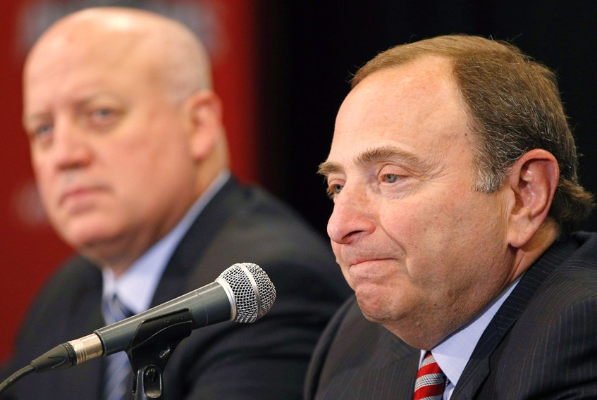 NHL commissioner Gary Bettman, right, and deputy commissioner Bill Daly appear in this file photo from the NHL Awards show on June 24, 2015, in Las Vegas.