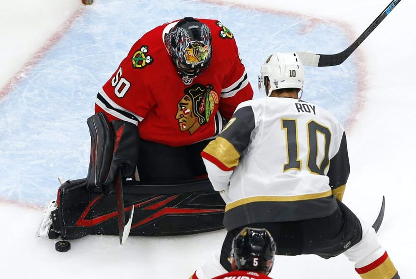 Chicago Blackhawks goaltender Corey Crawford (50) makes a save against Vegas Golden Knights center Nicolas Roy (10) during the first period in Game 4 of the first round of the 2020 Stanley Cup Playoffs at Rogers Place on Sunday Aug. 16, 2020. Mandatory Credit: