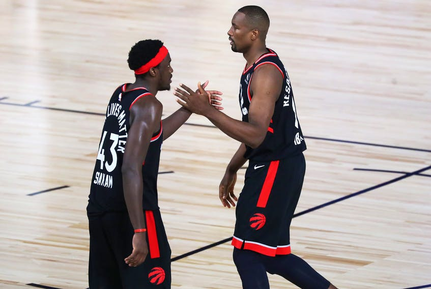 Raptors big men Serge Ibaka (right) and Pascal Siakam celebrate during their Game 4 win.