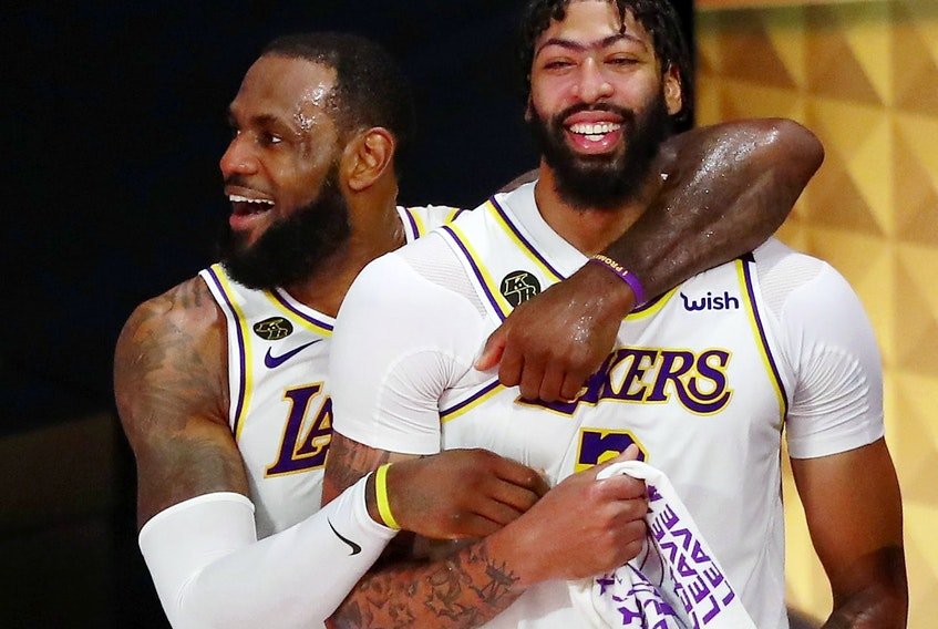 Lakers forward LeBron James (23) and forward Anthony Davis (3) celebrate during the fourth quarter in game six of the 2020 NBA Finals at AdventHealth Arena. The Los Angeles Lakers won 106-93 to win the series. Credit: Kim Klement-USA TODAY Sports ORG XMIT: IMAGN-430889