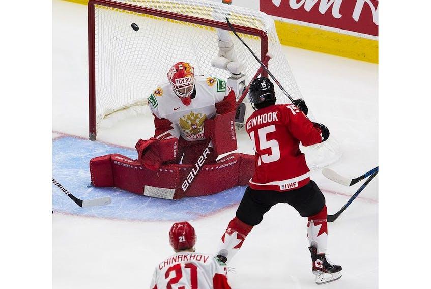 Canada's Alex Newhook (15) scores on Russia's Yaroslav Askarov (1) during first period IIHF World Junior Hockey Championship semifinal action on Monday, Jan. 4, 2021 in Edmonton.