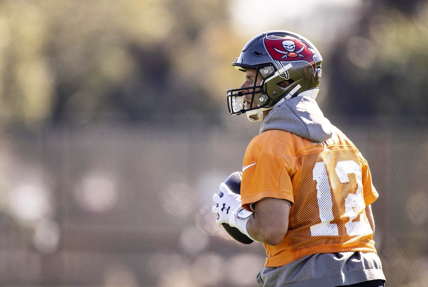 Buccaneers quarterback Tom Brady limbers up during a Super Bowl practice on Thursday in Tampa.