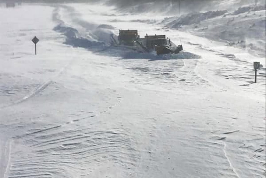 Pitts Memorial Drive on Saturday near the Ruth Avenue interchange. Transportation and Works crews reported drifts on some highways between 12 and 15 feet high.