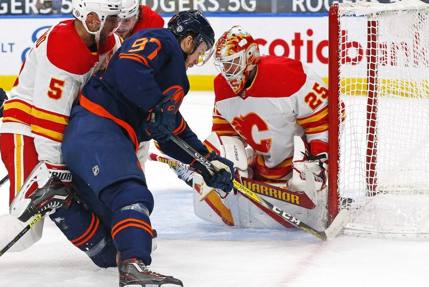 Edmonton Oilers forward Connor McDavid (97) shoots the puck against Calgary Flames goaltender Jacob Markstrom (25) during the third period at Rogers Place on Mar. 6, 2021.