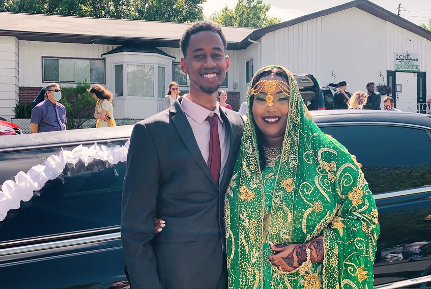 Amina Abawajy (right) and Hamza Youssouf in front of their limo after their wedding ceremony at Al Baraka Masjid. The couple celebrated their wedding on Saturday, June 20.