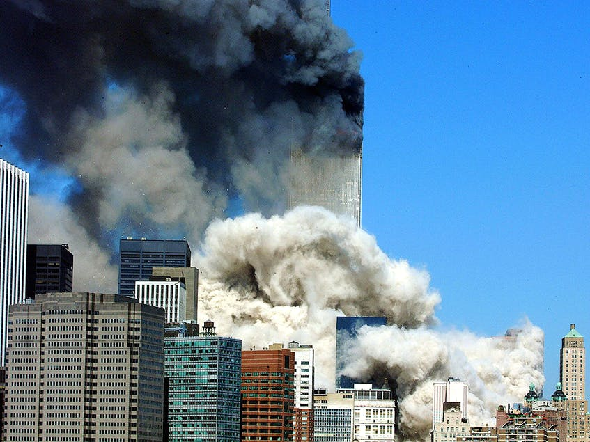 In this file photo taken on September 11, 2001, smoke billows after the first of the two towers of the World Trade Center collapses in New York City. (HENNY RAY ABRAMS/AFP/Getty Images) - Postmedia News