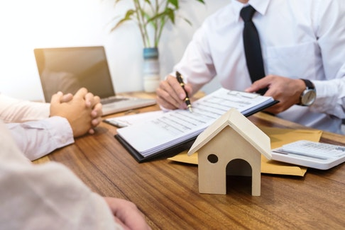 It's a good idea to get pre-approved for a mortgage before making any big decisions. - 123RF Photo.