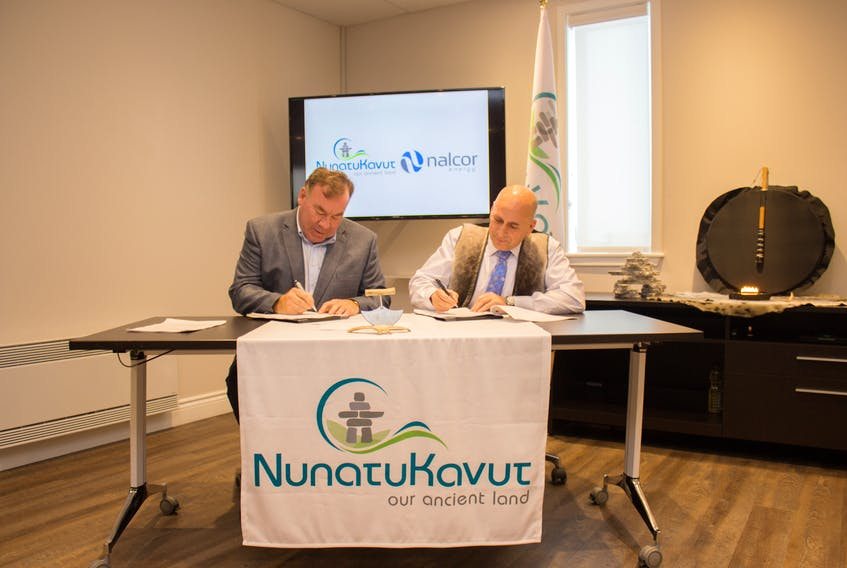 Nalcor CEO Stan Marshall and NCC President Todd Russell signing the Community Development Agreement between the energy giant and the indigenous organization.