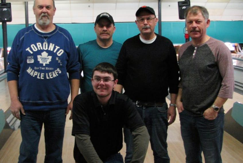 Members of regular season champion Appraisal Central team are (front) Greg Beson; (back, from left) Dale Green, Roy Loveridge, Brian Reid and Mike Gardner. Missing from photo is Frank Beson.