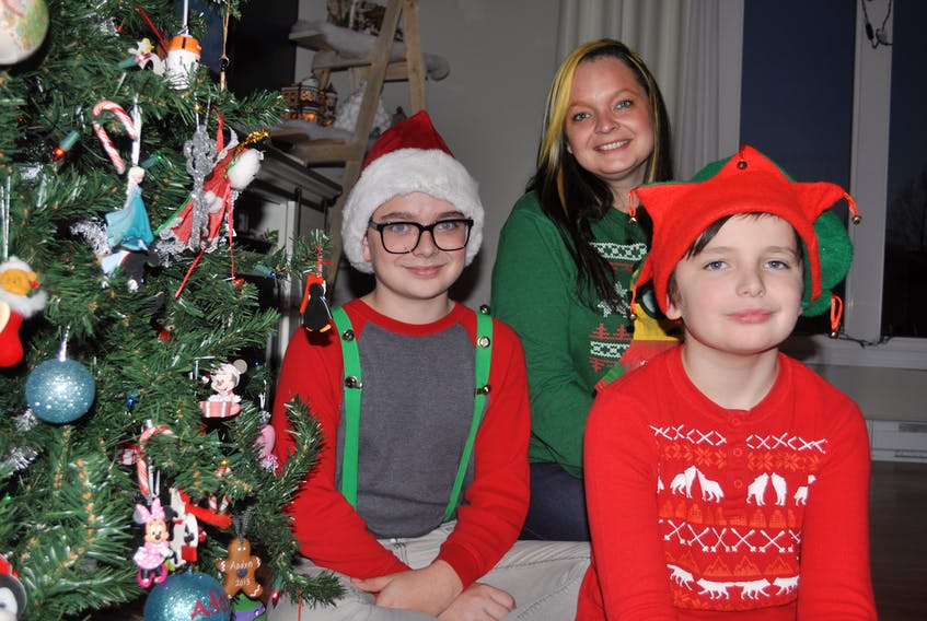 For the fourth year, the Tibbs family – Declan, Danielle and Xander, along with their dad Chris (missing from photo) – will deliver Christmas dinner to families in need throughout the Exploits Valley in memory of Chris' grandmother, Jane Budgell, who passed away in 2014.
