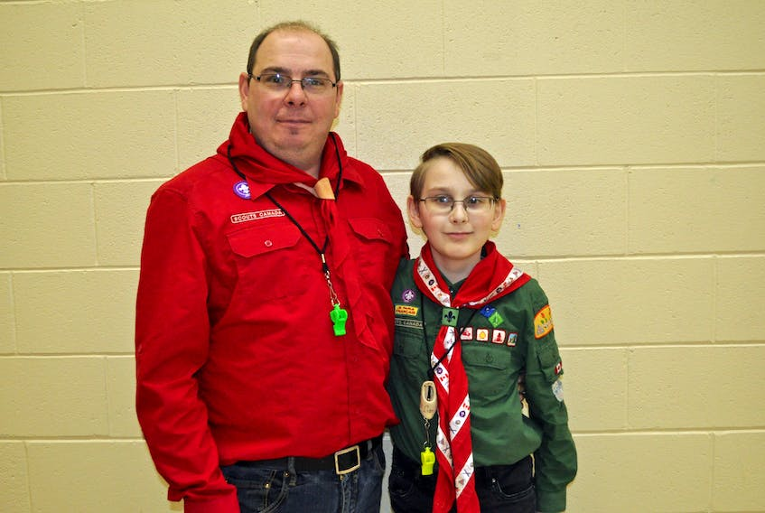 Gerry Gardner, left, and his son Liam Gardner will soon both be wearing red Scouter shirts as Liam is completing the process of becoming a Scouter and will be leading the Beavers and Cubs soon with his father.