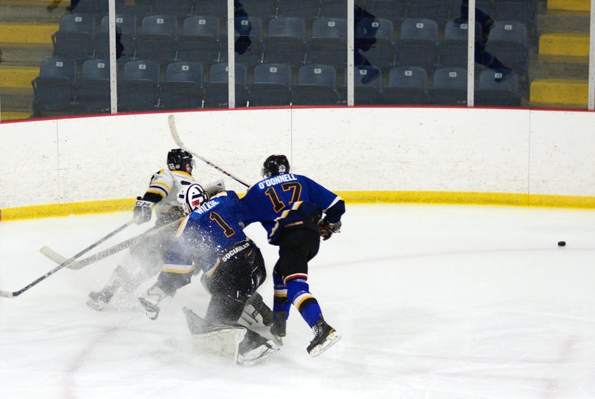 Trent Wilkie came a long way out of his net to poke-check the puck during third period action last Sunday in Springhill. Wilkie made 69 saves in the game, while the Blues managed 18 shots on the Antigonish Bulldogs net.