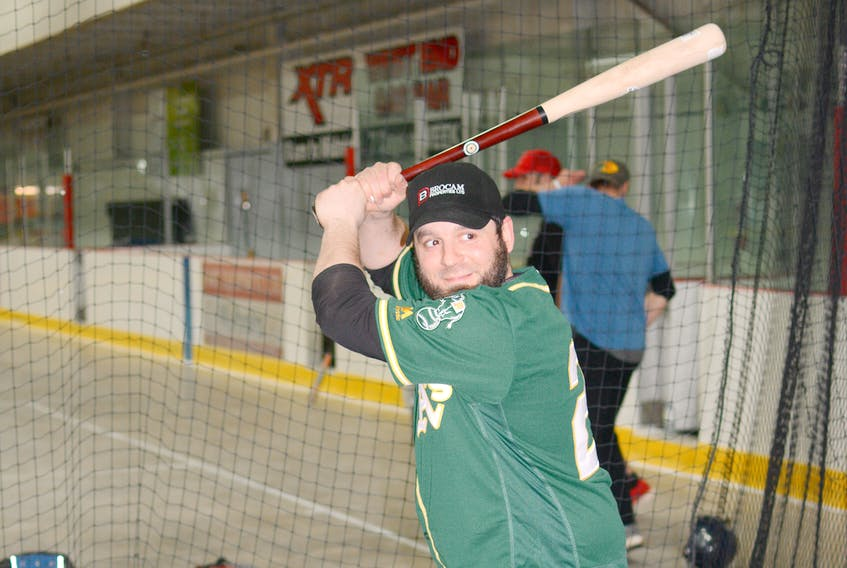 Gus Tupper, seen here taking swings in the batting cage in Springhill, had two hits and scored twice in their 7-1 win over the Truro Bearcats.