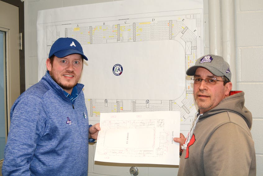 Corey Crocker, chair of the operations committee for the Fred Page Cup, and Ron Lake, acting president of the Amherst Ramblers, stand in front of the Fred Page Cup seating map. There are currently about 200 Fred Page Cup packages sold to the public so far, and about 200 set are aside for the teams coming to compete in Amherst for the Fred Page Cup.