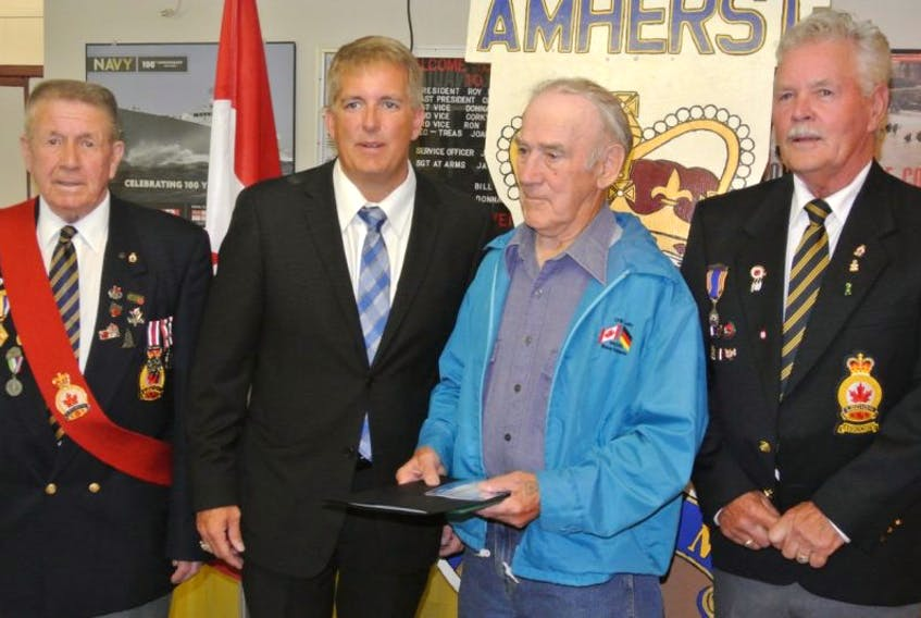Cumberland Colchester Musquodoboit Valley MP Scott Armstrong announced $19,500 in funding for the Amherst branch of the Royal Canadian Legion on Tuesday. During the announcement he presented a certificate of appreciation to Korean War veteran Robert Negus while sergeant at arms Jack Perry (left) and branch president Roy Porter (right) look on.