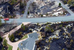 The province's department of lands and forestry says it's a matter of when, and not if, wildfires will destroy homes in Nova Scotia again, as happened on Fortress Drive in Fergusons Cove during the 2009 Spryfield fire outside Halifax. - File