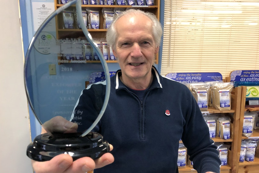 Valley Flax Flour Ltd. owner and general manager Howard Selig holds up the Annapolis Valley Chamber of Commerce's Outstanding Exporter of the Year award that his Middleton company earned. The award was presented Nov. 1.