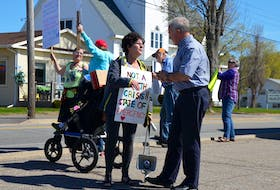 About 20 people protested in front of West Kings MLA Leo Glavine's office May 7. They want the provincial government to admit a health care crisis exists and even a state of emergency. Glavine came out and spoke with the placard-carrying residents and listened to their concerns.