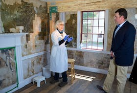Conservator Ann Shaftel was brought in to uncover an extensive mural under the wallpaper in an upstairs room at Annapolis Royal's Sinclair Inn Museum in the summer of 2016. West Nova MP toured the museum and even helped Shaftel gently scrape away the moistened wallpaper using a scalpel. He'll be back on May 15 for the Painted Room's official opening.