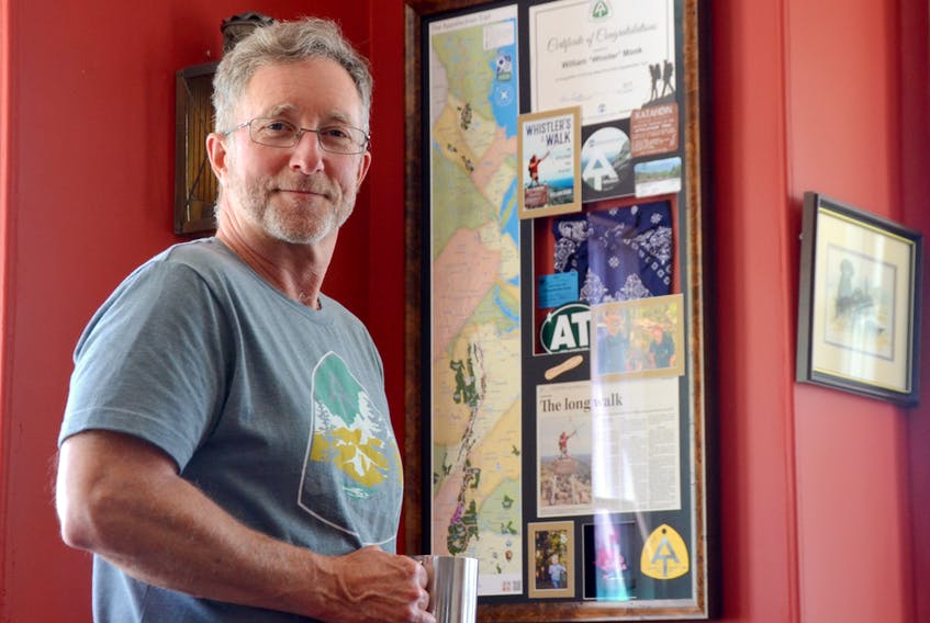 Bill Monk of Granville Ferry stands beside a collage of Appalachian Trail memorabilia created for him as a gift. Monk completed a through-hike of the trail in 2017 and wrote the book 'Whistler's Walk: The Appalachian Trail in 142 Days.' On April 11 he starts the Pacific Crest Trail, 4,270 kilometres from Mexico to British Columbia.
