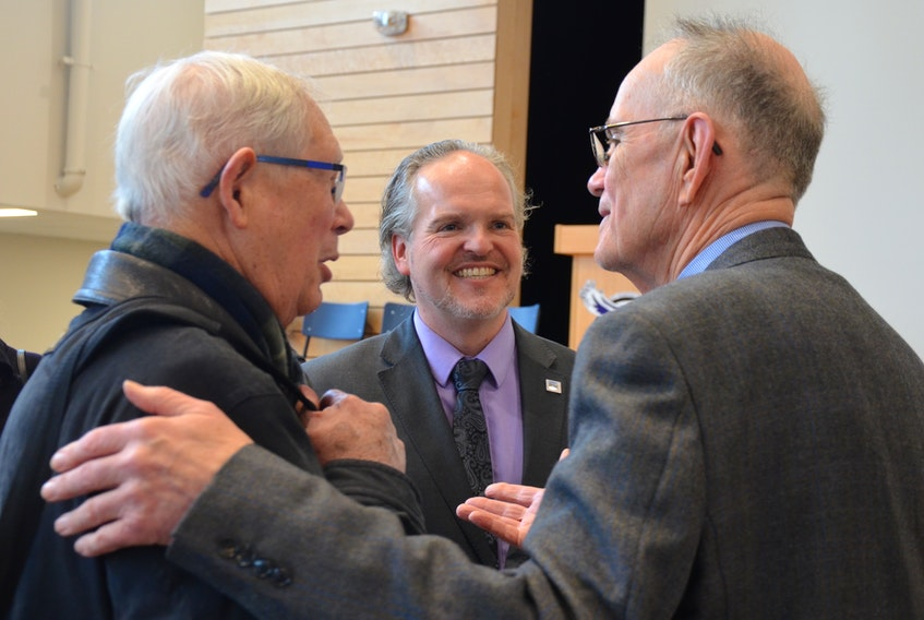 Annapolis County Warden Timothy Habinski, centre, talks with Gordonstoun curriculum developer Richard Thorne, left, and developer Edward Farren after it was announced Dec. 8 Gordonstoun Nova Scotia would locate in Annapolis County.