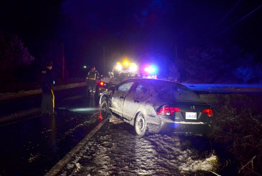 This Honda Civic slid into the ditch in Brickton just east of Lawrencetown Wednesday evening (Dec. 13) just after 7 p.m. Temperatures dropped to freezing and snow was falling, making road suddenly treacherous.