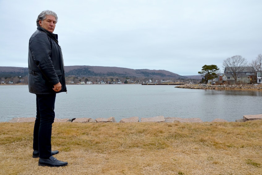 Annapolis Royal Mayor Bill MacDonald stands on the old wharf below Fort Anne. If sea level rise projections are even close to being accurate, the historic structure could be routinely under water before the end of the century. It would be just the first of local built heritage to be affected. The town is preparing to tackle the issue of sea level rise and other environmental concerns.