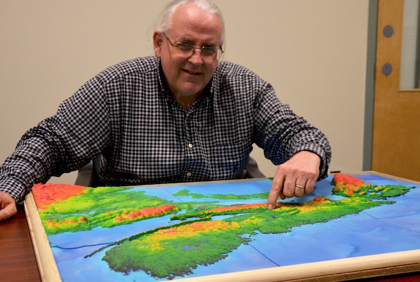 Dr. Tim Webster points to a 3-D map of Nova Scotia. Sea level rise will affect many communities over the next century. The research scientist with the Applied Geomatics Research Group at the NSCC Annapolis Valley Campus, Middleton charts coastline elevations using LiDAR (Light Detection and Ranging) and creates maps overlaid with sea level rise projections, high tides, and storm surge numbers to show where flooding will occur.
