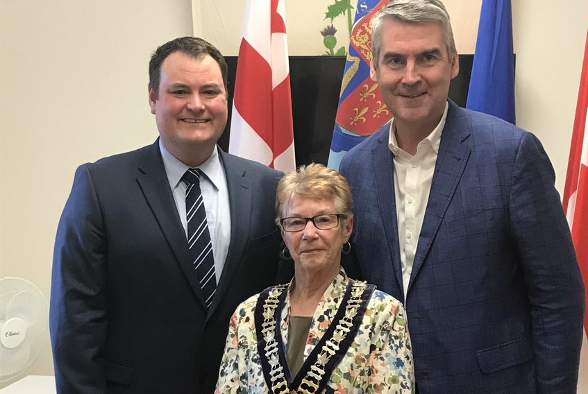 West Nova MP Colin Fraser, Annapolis Royal Deputy Mayor Pat Power, and Nova Scotia Premier Stephen McNeil announced funds April 23 for a $350,000 that will put a roof on the farm market and convert an old bus garage into public washrooms and a retail space.