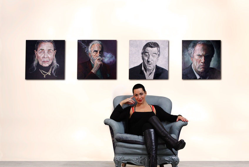 Angela Hardy in front of her artwork.
