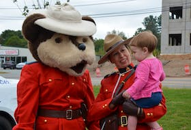 14-month-old Britton Schroeder meets the RCMP Safety Bear and Const. Jennifer Britton at an open house held at the new Kings District RCMP headquarters in New Minas. KIRK STARRATT