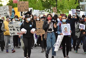 Stand for Black Lives protestors marched down Main Street in Wolfville, en route to Willow Park, after outgrowing the designated meeting space at Clock Park.