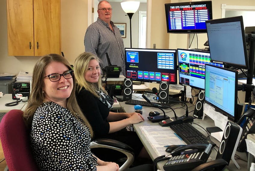 David Cunningham, Katie MacKay and Allison Ruggles all play a role in the emergency services support offered out Valley Communications in Kentville.