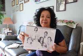 """Author and poet Juanita Pleasant with """"Aaliyah's Walk Through History 1604-2020"""", a calendar celebrating Black history that she plans to send to Annapolis Valley schools."""