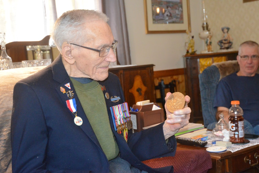 Second World War veteran Kenneth Keddy of Greenwood reflects on the medal he was awarded for his service with the First Special Forces. SAM MACDONALD
