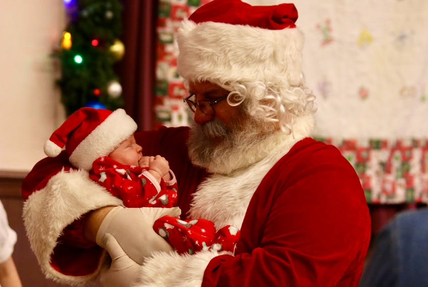 Santa met one-month-old Abigail Wadden — one of his newest fans — at the Christmas Angels webathon Dec. 1.