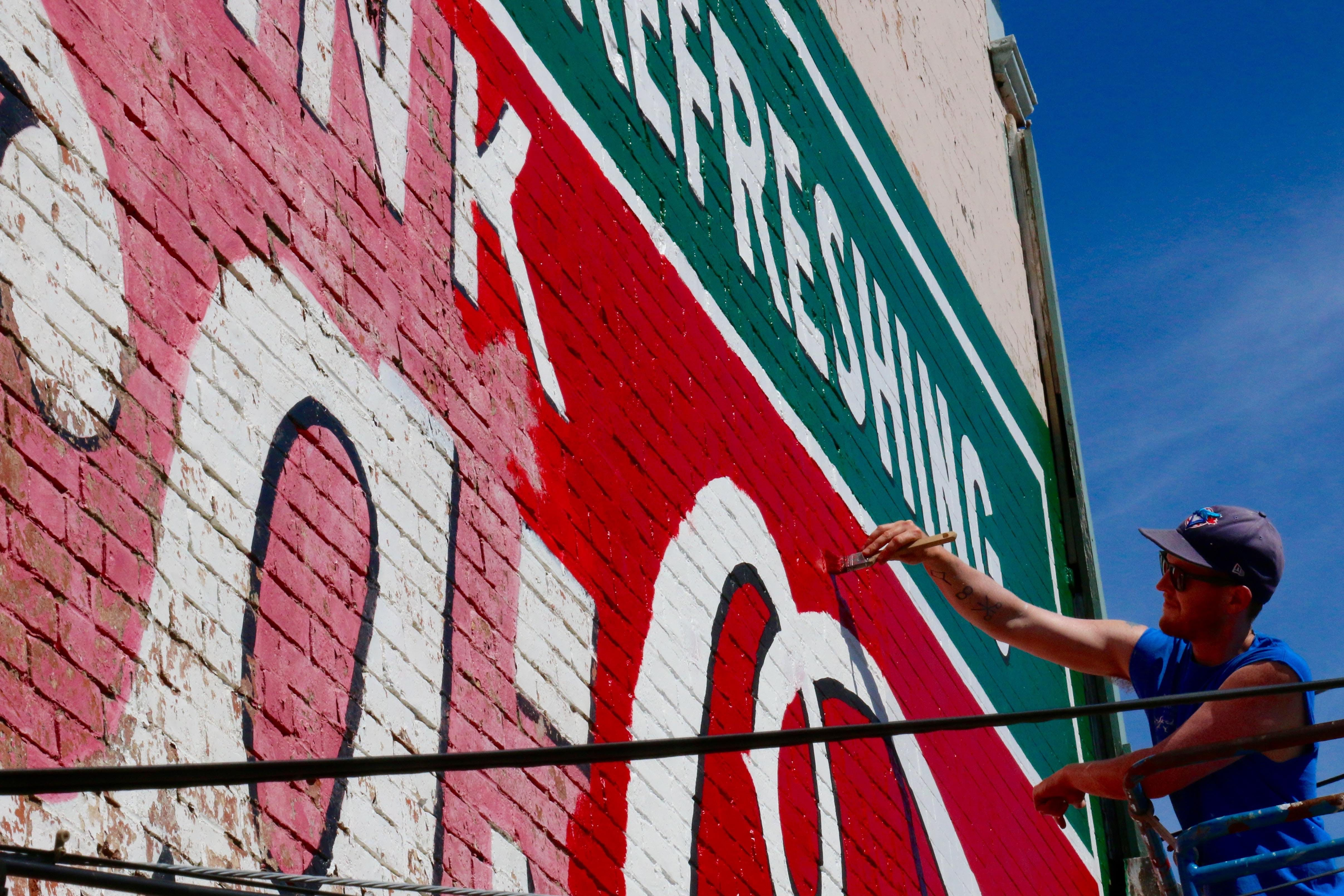 Markus Gallant has been helping repaint this iconic Coco-Cola mural, located in downtown Windsor, since July 7.