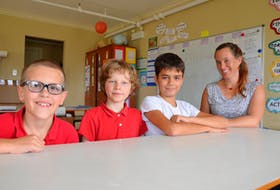Temma Frecker, right, who teaches a Grade 5 and 6 class at The Booker School in Port Williams, decided to give her students her vote for the upcoming federal election. Along with their classmates, Jacob Townsend, left, Forest Lussing and Mason Testroete are taking the responsibility very seriously.