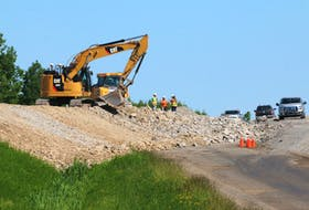 As temperatures soared to 30C June 19, construction crews were still working on the Highway 101 twinning project near Windsor.