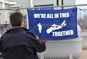 Const. Terry Garvin snaps a photo of a flag a local resident made for the Windsor West Hants RCMP detachment to show support following the devastating mass shooting in Nova Scotia.