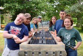 4-H members in the Annapolis Valley and their counterparts in Saskatchewan took part in a community project at Melvern Square at Outside the Box Skills Program Society recently. They created a raised garden for the Outside the Box members. From left are Nick, John, Alexandra, Kade, Jayne, Liam, and Hailey. The 4-Hers were part of a summer exchange program.
