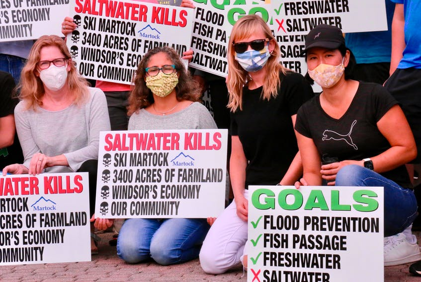 Dozens of people attended a parade to raise awareness of the importance of maintaining a freshwater lake in Windsor on Sept. 27.