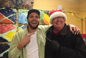 Wolfville-based singer-songwriter Daniel James McFadyen is shown with Mayor Jeff Cantwell on Dec.18 after the much-anticipated video release of McFadyen's new popular single Goin' Back (The Wolfville Song).