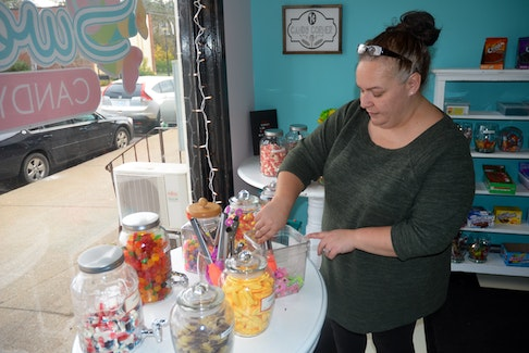 Amy Sertis gathers candy or an order at Sweeties Candy and Gifts in downtown Berwick. Orders and visits have been steady since the candy shop opened on Oct. 19.